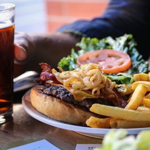 "Cause when you brew great beer, you're going to want to cook with it... Check out our lunch fave ""Brewers Bison Burger"" with smoked cheddar, hand-cut bacon, crispy onion, lettuce, pickles, housemade steak sauce on a #RailyardAle bun."
